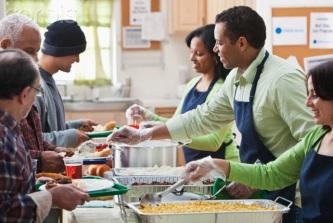 Volunteers serving in a soup kitchen --- Image by © JLP/Jose L. Pelaez/Corbis